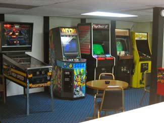 Whether you prefer pinball games pool or a quiet game of cards our recreation room offers the perfect space for your enjoyment. & The Golden Door Motel Game Room